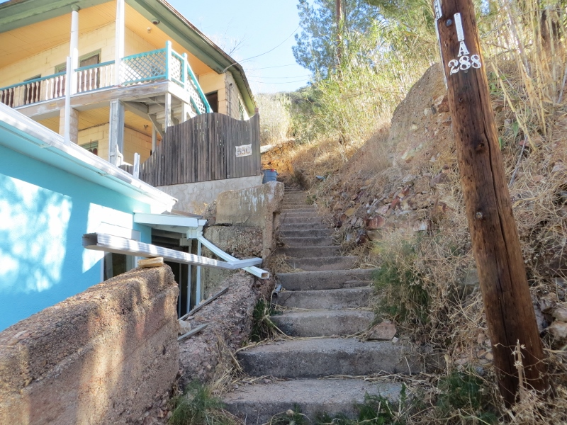 As you climb stairs, you'll find that some wind around to reach houses.