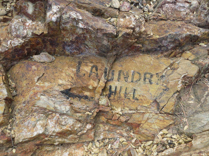 We also saw this faded sign painted in the rocks pointing the way to Laundry Hill on the other side of town.