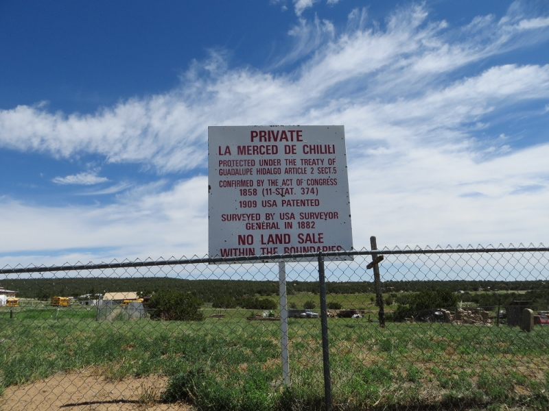 This sign is in front of the church. The Treaty of Guadalupe Hidalgo was signed at the end of the Mexican War. It included a provision to respect land grant rights in lands taken over by the United States. The bottom line is that Chilili probably considers itself a sovereign nation.