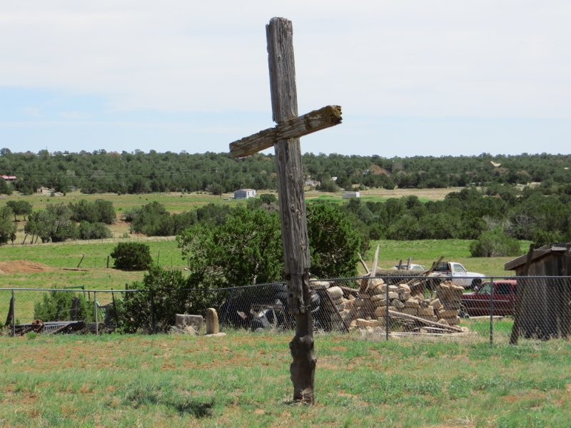 There is a nice cross in front of the church.