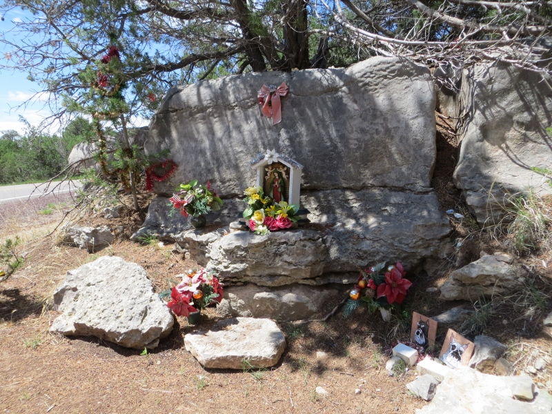Here's a closer look at the shrine. I hope the pictures of animals do not mean that small children were involved in any possible accident.