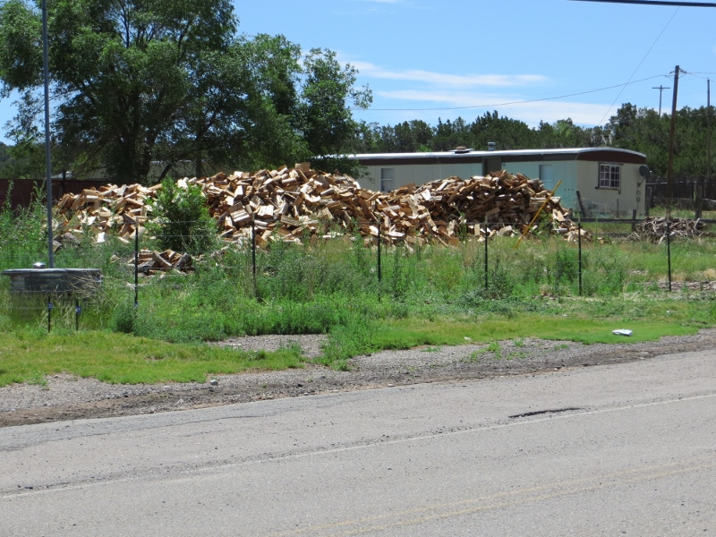 Firewood is piled everywhere in Tajique.