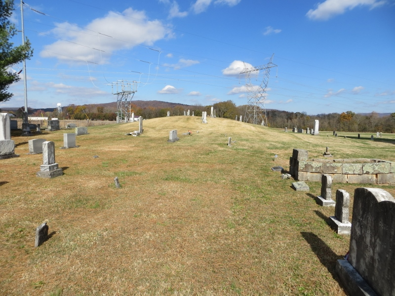 That bump in the ground covered with tombstones is an Indian mound. The Cumberland Plateau is in the background.
