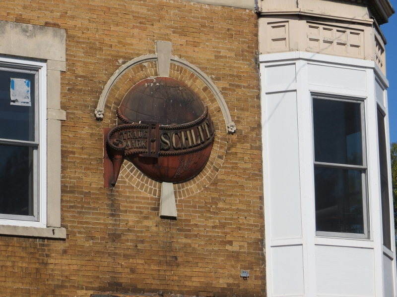 "If you're walking around a neighborhood, keep an eye out for something distinctive. The ""Schlitz"" globe indicated that this was a pre-prohibition era ""tied house"" owned by Schlitz Brewery. This tied house is located at the corner of 35th and Western."