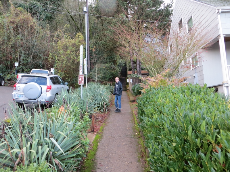 When my grandson and I zagged rather than zigged at Barbur Blvd., we found a 26-step stairway that took us up to this sidewalk. The stairway at the end of the sidewalk has 50 steps and leads to a brick path.