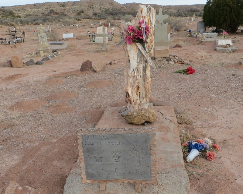 "If you wander through an old Hispanic burial ground in New Mexico, you might find an example of punched tin work. The saying on marker says ""Que Dios Te Bendigo"" which means ""God Bless You"". The marker dates to 1993 and is all in Spanish. Later markers are in English. A cultural anthropoligists could determine when Hispanic communities in New Mexico transitioned from Spanish speaking to English speaking. This is another example of what you can learn when you wander."